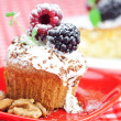 Muffin with whipped cream, cake with icing, raspberry, blackberr - Stock Photo