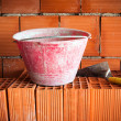 Trowel, bucket and bricks — Stock Photo