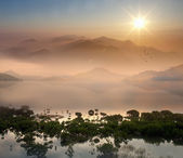 Morning lake landscape with sunrise — Stock Photo