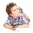 Pensive little boy with weird hair and magnifier — Stock Photo