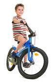 Happy little boy on bike — Stock Photo
