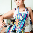 Young housewife on domestic kitchen — Stock Photo #11193762