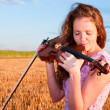 In love with music. Womkisses violin — Stock Photo #11921370