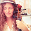 ������, ������: Portrait of street musician woman with cello
