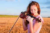 In love with music. Woman kisses the violin — Stock Photo