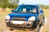 Offroad car drive with woman steering — Stock Photo