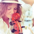 Portrait of street musician woman with cello — Stock Photo