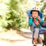 Little boy in bike child seat — Stock Photo