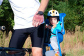 Little boy in bike child seat — Stock Photo