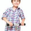 Naughty hairy little boy in shorts and shirt with scooter - Stock Photo