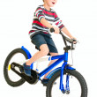 Happy naughty little boy riding bike - Stock Photo