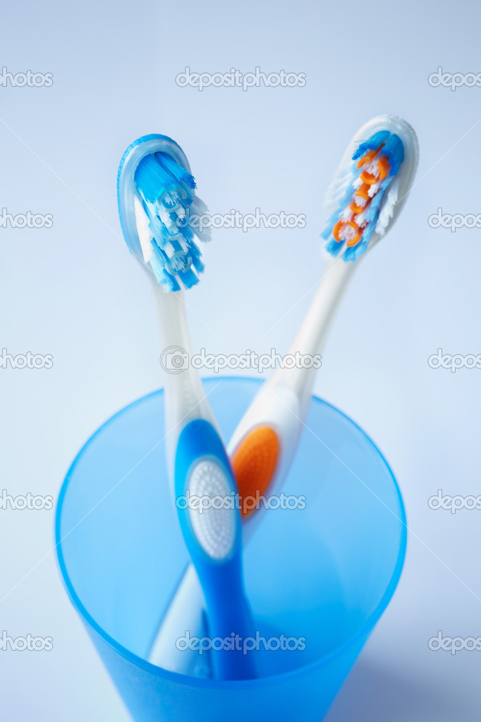 Toothbrushes in closeup, selective focus on nearest (blue)  Foto de Stock   #11839281