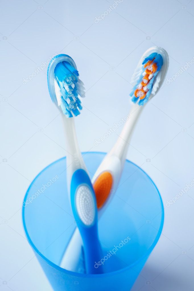 Toothbrushes in closeup, selective focus on nearest (blue)  Stockfoto #11839281
