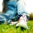 Stock Photo: Red sneakers on girl legs