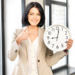 Businesswoman with clock — Stock Photo #10748836