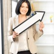 Businesswoman with direction arrow sign — Stock Photo #10748852