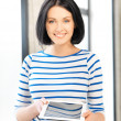 Happy teenage girl with tablet pc computer — Stock Photo #10748956