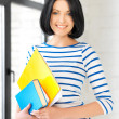 Happy teenage girl with books and folders — Stock Photo