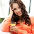 Beautiful woman with glass of juice — Stock Photo #10749795