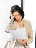 Calm woman with documents — Stock Photo