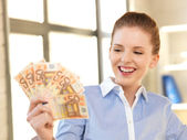 Lovely woman with euro cash money — Stock Photo