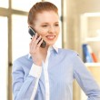 Businesswoman with cell phone — Stock Photo #10810156