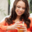Beautiful woman with glass of juice — Stock Photo #10810551