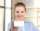 Confident woman with business card — Stock Photo