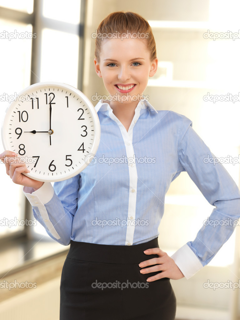 Bright picture of attractive businesswoman with clock — Stock Photo #10810070