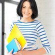 Happy teenage girl with books and folders — Stock Photo #10833242