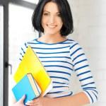 Happy teenage girl with books and folders — Stock Photo