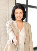 Woman with an open hand ready for handshake — Stockfoto