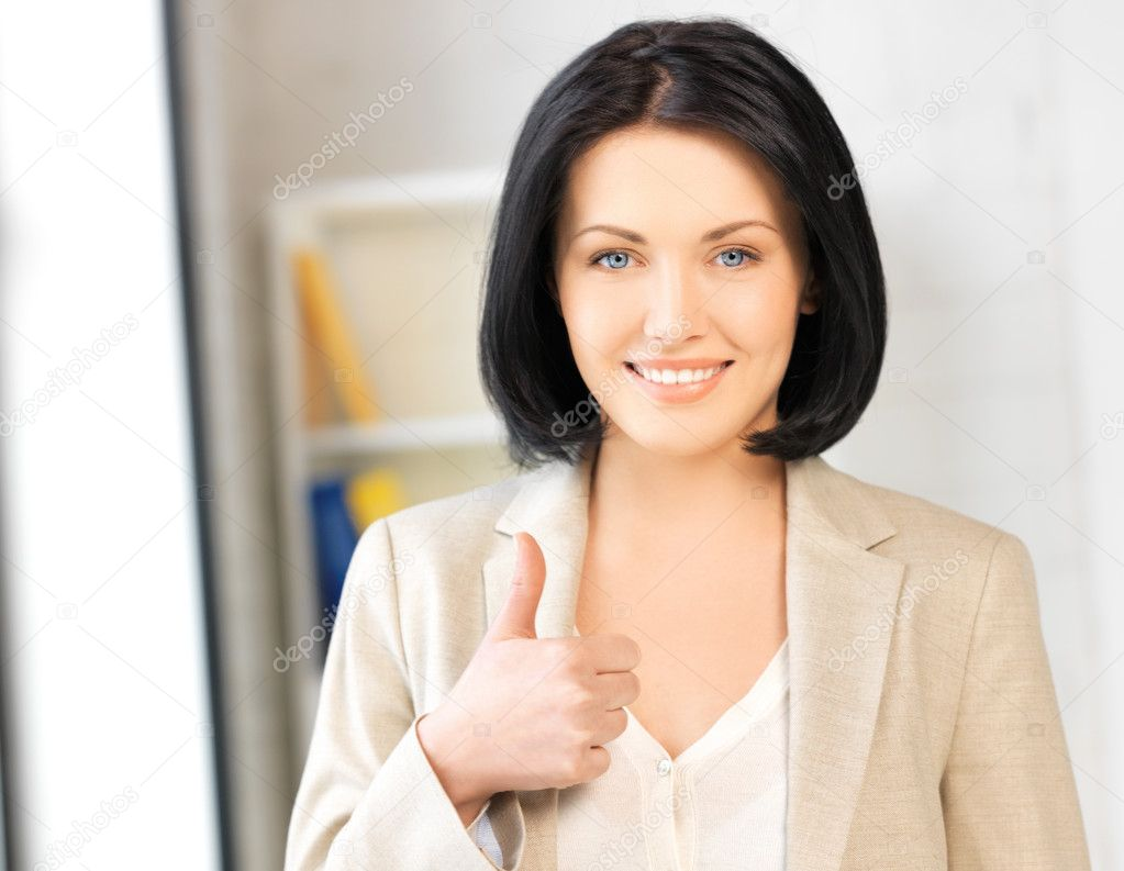 Bright picture of young woman with thumbs up — Stock Photo #10832837