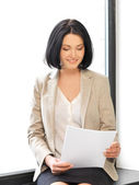 Happy woman with documents — Foto Stock