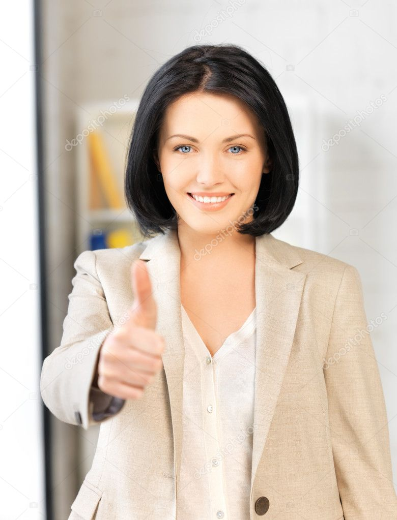 Bright picture of young woman with thumbs up  Stock Photo #10930137