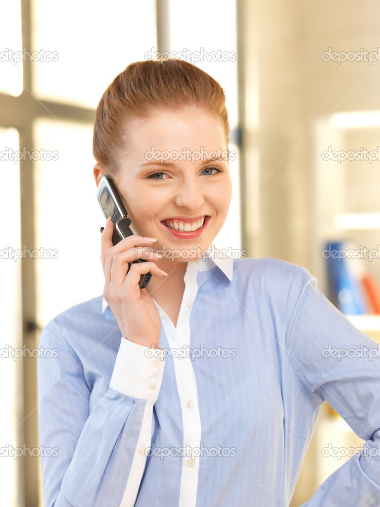Bright picture of businesswoman with cell phone — Stock Photo #10930582