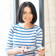 Happy teenage girl with tablet pc computer — Stock Photo