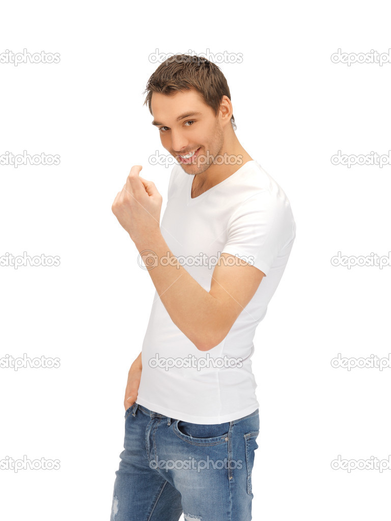 Man in white shirt making inviting gesture stock photo for Man in white shirt