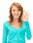 Teenage girl showing ok sign — Stock Photo