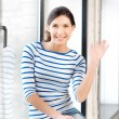 Happy teenage girl waving a greeting - Stockfoto