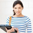 Happy teenage girl with tablet pc computer - Stockfoto