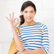 Happy teenage girl showing ok sign - Stockfoto