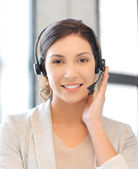 Friendly female helpline operator — Stockfoto