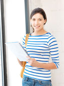 Happy and smiling teenage girl with big notepad — Stock Photo