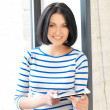 Happy teenage girl with tablet pc computer — Stockfoto