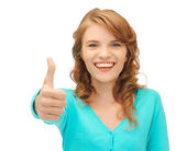 Teenage girl with thumbs up — Stock Photo