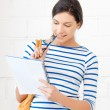 Happy and smiling teenage girl with big notepad — Foto Stock