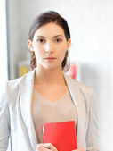 Calm and serious woman with book — Stock Photo