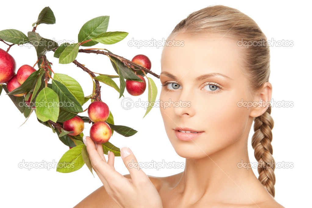 Picture of lovely woman with apple twig — Stock Photo #11314380