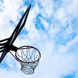 Basketball basket over blue sky - 图库照片
